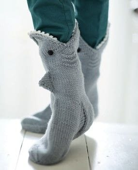 Knitted Animal Socks and Hats .  Free tutorial with pictures on how to make a sock in 8 steps by knitting with yarn, shank buttons, and knitting needles. Inspired by sharks. How To posted by Ryland Peters & Small.  in the Yarncraft section Difficulty: 3/5. Cost: 3/5.