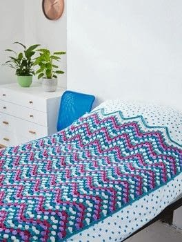 Modern Crocheted Blankets, Throws & Cushions .  Free tutorial with pictures on how to stitch a knit or crochet blanket in 3 steps by crocheting with yarn, crochet hook, and stitch marker. How To posted by Ryland Peters & Small.  in the Yarncraft section Difficulty: 3/5. Cost: 3/5.