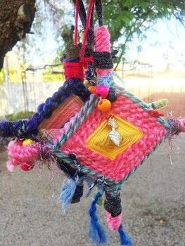 Ojo De Dios weaving using your yarn scraps. .  Free tutorial with pictures on how to make an ornament in under 60 minutes by weaving with yarn, beads, and stick(s). How To posted by Vesna T.  in the Art section Difficulty: Easy. Cost: No cost. Steps: 6