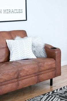 I painted my Microfiber couch to look like leather!  .  Free tutorial with pictures on how to make a sofa in 8 steps by decorating with paint, fabric softener, and brush. How To posted by Lily O.  in the Home + DIY section Difficulty: 3/5. Cost: Cheap.