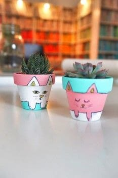 Paint your own cat inspired cactus plant pots! .  Free tutorial with pictures on how to make a vase, pot or planter in under 20 minutes by decorating with plant pots, pencil, and masking tape. Inspired by cats. How To posted by Cat Morley.  in the Decorating section Difficulty: Simple. Cost: Cheap. Steps: 15