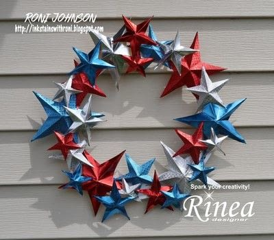 Celebrate your patriotism in style with this smashing wreath! .  Free tutorial with pictures on how to make a paper wreath in under 60 minutes by papercrafting and paper folding with rinea foiled papers, 5 point star pattern, and scissors. Inspired by america and 4th of july. How To posted by Ink Stained Roni.  in the Papercraft section Difficulty: Simple. Cost: Cheap. Steps: 7
