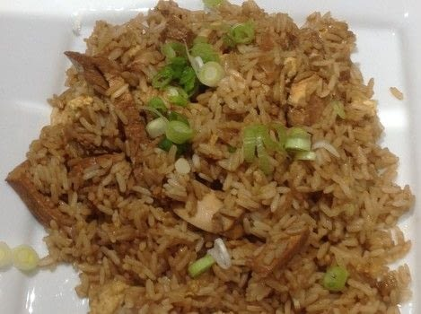 .  Free tutorial with pictures on how to cook a fried rice dish in under 30 minutes by cooking with rice, onions, and garlic. Inspired by chinese and chicken. Recipe posted by Super Madcow.  in the Recipes section Difficulty: Easy. Cost: Cheap. Steps: 8