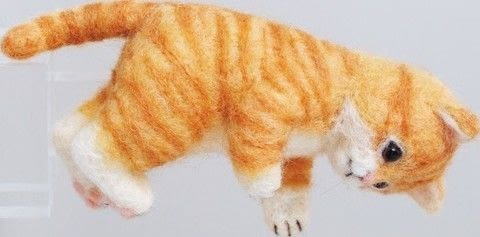 Cute Needle Felted Animal Friends .  Free tutorial with pictures on how to make a cat plushie in under 120 minutes by needleworking, needlepointing, and felting with batting, wool roving, and crystal. Inspired by cats. How To posted by Tuttle Publishing.  in the Needlework section Difficulty: Simple. Cost: 3/5. Steps: 21