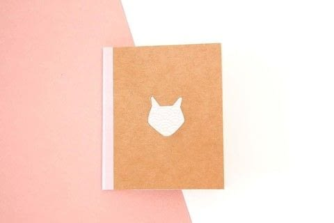 Customize a notebook with this quick tutorial .  Free tutorial with pictures on how to make a paper book cover in under 20 minutes by papercrafting and bookbinding with white pen, masking tape, and pencil. Inspired by foxes. How To posted by Manayin.  in the Papercraft section Difficulty: Easy. Cost: Cheap. Steps: 5