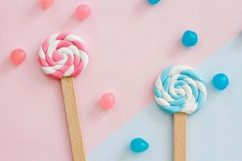How to make lollipop bookmarks ! .  Free tutorial with pictures on how to mold a clay bookmark in under 30 minutes by molding with ice cream sticks, porcelain, and varnish. Inspired by lollipops. How To posted by Manayin.  in the Home + DIY section Difficulty: Simple. Cost: 3/5. Steps: 8