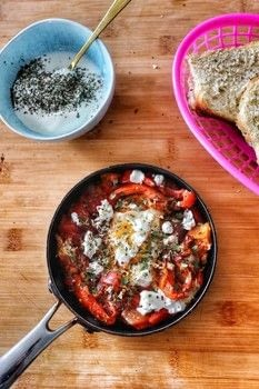 Middle Eastern inspired shakshouka with tomatoes, red peppers, onion and feta! .  Free tutorial with pictures on how to cook a vegetable dish in under 25 minutes by cooking with tomatoes, red pepper, and onion. Recipe posted by Cat Morley.  in the Recipes section Difficulty: Simple. Cost: Cheap. Steps: 11