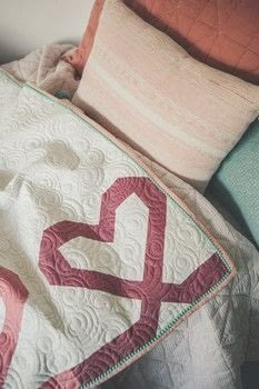 Dreamy Quilts .  Free tutorial with pictures on how to make a patchwork quilt in 8 steps by sewing and patchworking with fabric, blanket, and binding. Inspired by hearts. How To posted by Search Press.  in the Sewing section Difficulty: 3/5. Cost: 3/5.