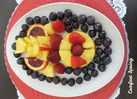 Colorful, easy and tasty spring fruit platter .  Free tutorial with pictures on how to make a fruit salad in under 15 minutes by cooking and decorating food with pineapple, strawberries, and grapes. Recipe posted by ComfortSpringSt.  in the Recipes section Difficulty: Simple. Cost: Cheap. Steps: 5