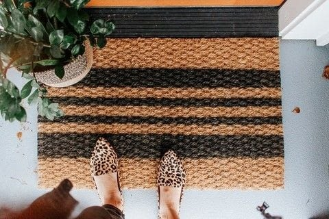 DIY Painted Striped Doormat .  Free tutorial with pictures on how to make a door mat in 3 steps using spray paint, doormat, and painter's tape. How To posted by Decor Hint.  in the Decorating section Difficulty: Simple. Cost: Cheap.