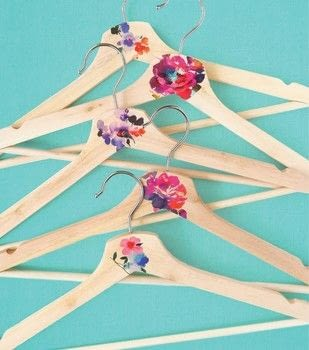 Hello Color .  Free tutorial with pictures on how to make a clothes hanger in under 20 minutes by decorating with hangers, temporary tattoos, and scissors. How To posted by Quirk Books.  in the Home + DIY section Difficulty: Simple. Cost: Cheap. Steps: 3