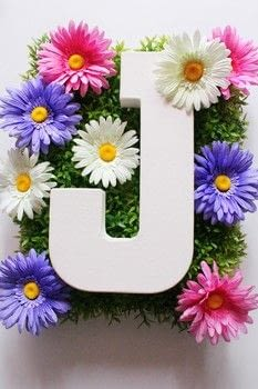 Create a Spring Themed Monogram .  Free tutorial with pictures on how to make a letter in under 30 minutes by decorating with canvas board, plastic grass, and fake flowers. How To posted by City_Shaysha.  in the Other section Difficulty: Easy. Cost: Cheap. Steps: 9