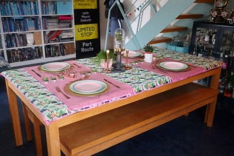 Create a tropical table setting with a home-sewn tablecloth and runners! .  Free tutorial with pictures on how to make a tablecloth / table runner in under 120 minutes by sewing with fabric, polycotton, and silk ribbon. How To posted by Cat Morley.  in the Sewing section Difficulty: Simple. Cost: Cheap. Steps: 22