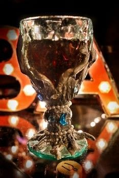 Turn a wine glass into your own Medieval Banquet inspired goblet! .  Free tutorial with pictures on how to make a glass in under 35 minutes by molding with glass, clay, and fork. How To posted by Cat Morley.  in the Home + DIY section Difficulty: Simple. Cost: Cheap. Steps: 16