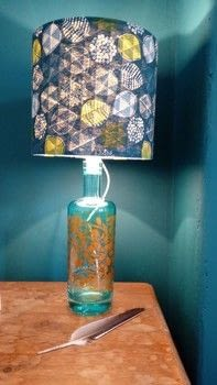 Illuminating recycling: bottle to lamp  .  Make a bottle lamp in under 60 minutes using gin, lamp shade, and lamp. Creation posted by Helen W.  in the Home + DIY section Difficulty: Simple. Cost: Cheap.