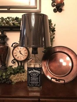 Here is a complete step by step process for creating your own bottle lamp. .  Free tutorial with pictures on how to make a bottle lamp in under 120 minutes using lamp shade, lightbulb, and lamp kit. How To posted by Nalani R.  in the Home + DIY section Difficulty: 3/5. Cost: Cheap. Steps: 8