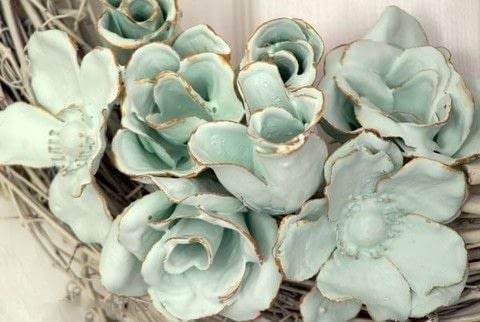 Create faux porcelain flowers  .  Free tutorial with pictures on how to make a flowers & rosettes in under 180 minutes by spraypainting with fabric flower, gloves, and plaster of paris. How To posted by Nalani R.  in the Home + DIY section Difficulty: Simple. Cost: Cheap. Steps: 8