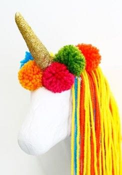 Dress your wall with this funky Unicorn head .  Free tutorial with pictures on how to make a taxidermy mount in under 180 minutes by yarncrafting with scissors, yarn, and glitter. Inspired by unicorns and homeware. How To posted by DiY Blonde.  in the Home + DIY section Difficulty: 3/5. Cost: 3/5. Steps: 4