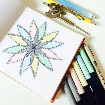 Mandala drawing made with a compass! .  Free tutorial with pictures on how to create a piece of abstract or patterned art in under 30 minutes by creating and drawing with pencil, cardstock, and markers. How To posted by Jen from Craftic.  in the Papercraft section Difficulty: Simple. Cost: No cost. Steps: 5