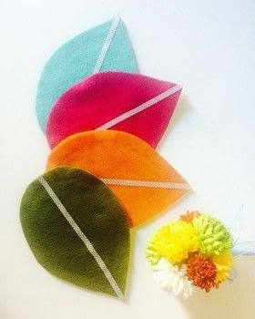Felt coasters in leaf shapes .  Free tutorial with pictures on how to sew a fabric coaster in under 60 minutes using felt, scissors, and glue gun. How To posted by Jen from Craftic.  in the Other section Difficulty: Simple. Cost: No cost. Steps: 5
