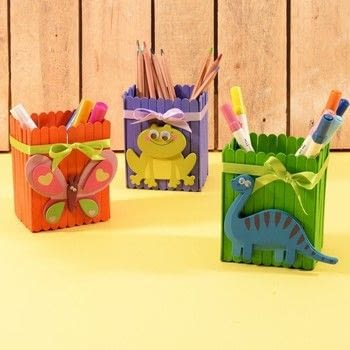 Cheerful pen holders made out of lolly sticks .  Free tutorial with pictures on how to make a mixed media in under 180 minutes How To posted by Vaessen Creative.  in the Other section Difficulty: Easy. Cost: Absolutley free. Steps: 5