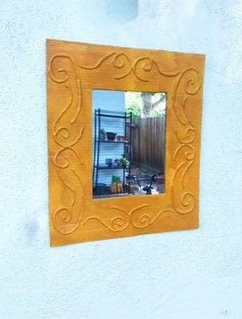 Using Recycled Cardboard and a Glue Gun .  Free tutorial with pictures on how to make a piece of recycled art in under 120 minutes using cardboard, spray paint, and mirror. How To posted by Heather M.  in the Art section Difficulty: 3/5. Cost: Cheap. Steps: 5
