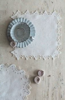 Whitework Embroidery .  Free tutorial with pictures on how to make a placemat in under 60 minutes by needleworking, embroidering, and hand sewing with linen, thread, and linen. How To posted by Search Press.  in the Needlework section Difficulty: 3/5. Cost: Cheap. Steps: 5