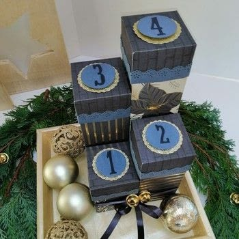 Scrapbook paper advent boxes .  Free tutorial with pictures on how to make a scrapbook in 14 steps How To posted by Vaessen Creative.  in the Papercraft section Difficulty: Easy. Cost: Cheap.
