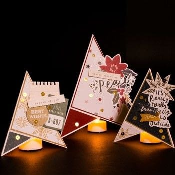DIY Christmas decoration: paper Christmas tree .  Free tutorial with pictures on how to make a Christmas decoration in 10 steps Inspired by christmas and trees. How To posted by Vaessen Creative.  in the Decorating section Difficulty: Simple. Cost: Absolutley free.