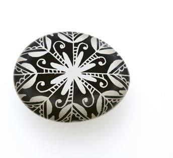 White-on-Black Snowflake Motif .  Free tutorial with pictures on how to make a decorative egg in under 60 minutes by creating with egg, candle, and lighter. Inspired by christmas, snowflakes, and easter eggs. How To posted by Search Press.  in the Art section Difficulty: Simple. Cost: Cheap. Steps: 6