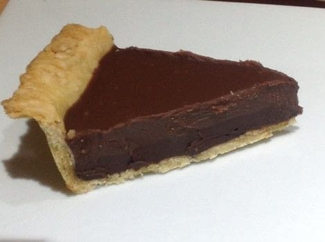 .  Free tutorial with pictures on how to bake a chocolate tart in under 30 minutes by cooking, baking, and decorating food with shortcrust pastry, dark chocolate, and heavy cream. Recipe posted by Super Madcow.  in the Recipes section Difficulty: Easy. Cost: Cheap. Steps: 7