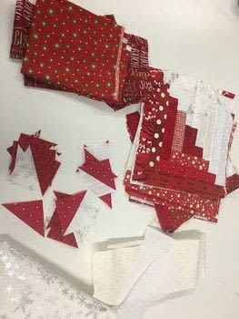 Log Cabin Christmas Tree Skirt .  Make a patchwork quilt by sewing and patchworking with fabrics. Inspired by christmas. Creation posted by Nancy H.  in the Sewing section Difficulty: Easy. Cost: 3/5.