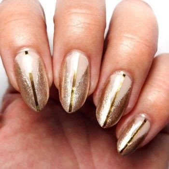 Nude Geometric Nails .  Free tutorial with pictures on how to paint a nail painting in under 60 minutes using nude nail polish, gold shimmer nail polish, and triangle nail vinyls. How To posted by Lacquered Lawyer.  in the Beauty section Difficulty: Easy. Cost: Cheap. Steps: 3