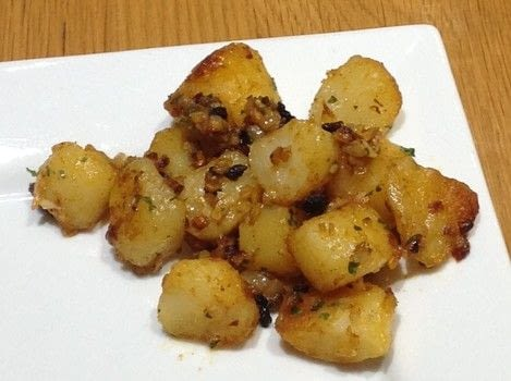 .  Free tutorial with pictures on how to cook a potato dish in under 40 minutes by cooking and baking with potatoes, garlic, and shallots. Recipe posted by Super Madcow.  in the Recipes section Difficulty: Easy. Cost: Cheap. Steps: 4