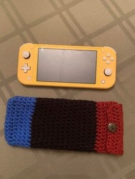 For gaming on the go! .  Free tutorial with pictures on how to stitch a knit or crochet bag in under 120 minutes by sewing, yarncrafting, crocheting, and hand sewing with worsted weight yarn, size h {5.0 mm} crochet hook, and scissors. Inspired by nintendo. How To posted by Violette Lovelace.  in the Yarncraft section Difficulty: Easy. Cost: Absolutley free. Steps: 5