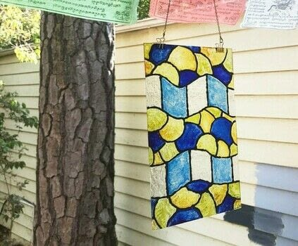 Discover how easy it is to make a faux stained glass masterpiece .  Free tutorial with pictures on how to make a sun catcher in 5 steps by embellishing, dyeing, and glassworking with glass, liquid leading, and alcohol inks. How To posted by Heather M.  in the Decorating section Difficulty: 3/5. Cost: 3/5.