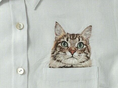 Embroidered Cat In My Pocket .  Free tutorial with pictures on how to make a needlecraft in 46 steps by embroidering with fabric, embroidery hoop, and embroidery needles. Inspired by cats. How To posted by Search Press.  in the Needlework section Difficulty: 3/5. Cost: Cheap.
