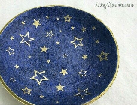 Glitter and metallic stars are perfect. .  Make a home accessory using polymer clay, acrylic paint, and glitter. Inspired by space and stars. Creation posted by Heather M.  in the Decorating section Difficulty: 3/5. Cost: 3/5.