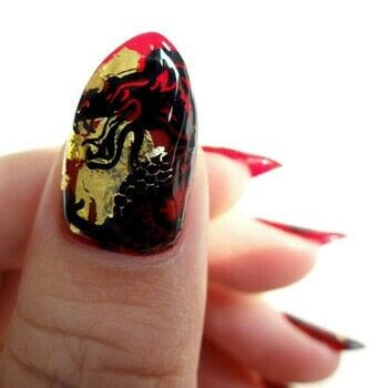 Mulan inspired nail art .  Free tutorial with pictures on how to paint a nail painting in under 60 minutes using gold flakes, red nail polish, and black stamping polish. How To posted by Lacquered Lawyer.  in the Beauty section Difficulty: Simple. Cost: 3/5. Steps: 3