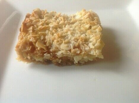 .  Free tutorial with pictures on how to bake a bar / slice in under 35 minutes by cooking and baking with digestive biscuits, butter, and white chocolate chips. Recipe posted by Super Madcow.  in the Recipes section Difficulty: Easy. Cost: Cheap. Steps: 5