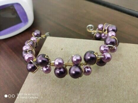 Wire wrapping with beads .  Make a beaded bracelet by beading, jewelrymaking, and wireworking with wire and wire tools, copper wire, and beads. Creation posted by CiiMoore.  in the Jewelry section Difficulty: Simple. Cost: Cheap.