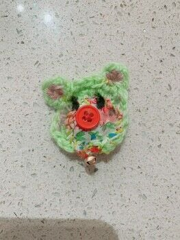 A little mint bear with a red button nose .  Make a fashion accessory in under 70 minutes by sewing, crocheting, and amigurumi with yarn, crochet hook, and embroidery thread. Inspired by animals, kawaii, and bears. Creation posted by Alex L.  in the Yarncraft section Difficulty: Simple. Cost: No cost.