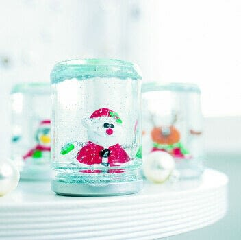 Snow globes make great gifts for friends and family, and children really enjoy making them. .  Free tutorial with pictures on how to make a snow globe in under 30 minutes by decorating with pitcher, decorations, and glue. Inspired by christmas. How To posted by Ryland Peters & Small. Difficulty: Simple. Cost: Cheap. Steps: 4