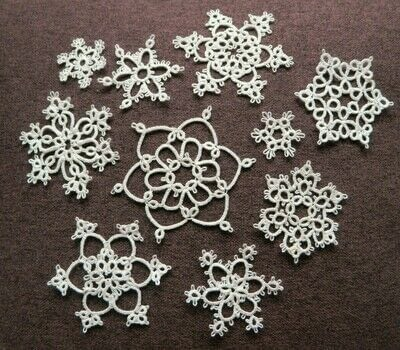 Delicate Tatted Lace Snowflakes .  Tie a knot by knotting, needleworking, and  with pearls and tatting shuttle. Inspired by christmas, snowflakes, and snowman. Creation posted by Alix Marie Abram.  in the Needlework section Difficulty: 4/5. Cost: Cheap.
