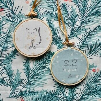 Hoop it Up Ornament / Decor .  Free tutorial with pictures on how to make an ornament in under 60 minutes by sewing with embroidery hoop, fabric, and satin ribbon. How To posted by Mister Domestic.  in the Sewing section Difficulty: Easy. Cost: No cost. Steps: 7