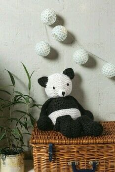 Robyn Octopus & Friends .  Free tutorial with pictures on how to make a panda plushie in 8 steps by knitting with merino, knitting needles, and polyester stuffing. Inspired by pandas. How To posted by Search Press.  in the Yarncraft section Difficulty: Simple. Cost: 3/5.