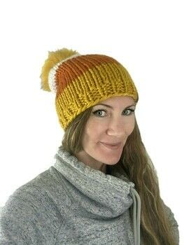 Candy Corn CUTE Hat .  Free tutorial with pictures on how to make a beanie in under 120 minutes by knitting with super bulky yarn, super bulky yarn, and super bulky yarn. Inspired by halloween, costumes & cosplay, and clothes & accessories. How To posted by Lovely by Lee.  in the Yarncraft section Difficulty: Simple. Cost: 3/5. Steps: 5