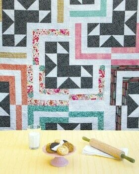 Jelly Filled .  Free tutorial with pictures on how to make a patchwork quilt in 21 steps by sewing, patchworking, and machine sewing with fat quarter, black fabric, and fabric. How To posted by C&T Publishing.  in the Sewing section Difficulty: 3/5. Cost: 3/5.