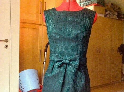 Retro styled dress to look fabulous in wintertime!  .  Free tutorial with pictures on how to make a gown in 9 steps by sewing, dressmaking, hand sewing, and machine sewing with buttons, invisible zipper, and sewing machine. How To posted by polkadot.  in the Sewing section Difficulty: 4/5. Cost: Cheap.