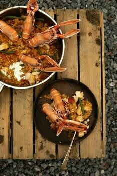 The Seafood Shack .  Free tutorial with pictures on how to cook a paella in under 60 minutes by cooking with langoustines, rapeseed oil, and garlic cloves. Recipe posted by Kitchen Press.  in the Recipes section Difficulty: Simple. Cost: 3/5. Steps: 4